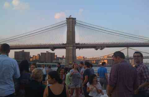 The agency taking advantage of our NYC home - happy hour with a view of the Three Bridges.